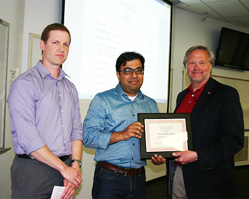 Assistant Professor Balachandran receives the Outstanding Service Award
